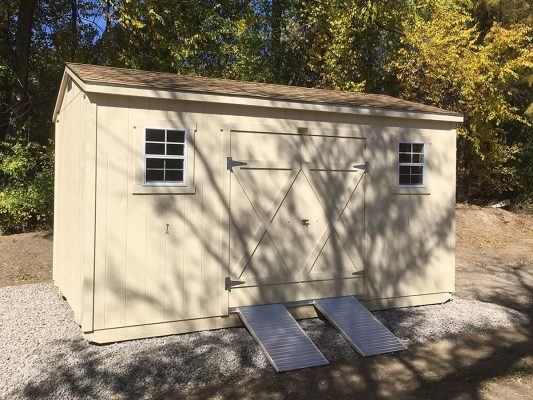 Ranch storage shed with double doors and ramp