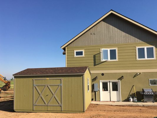 ranch shed painted to match house colors