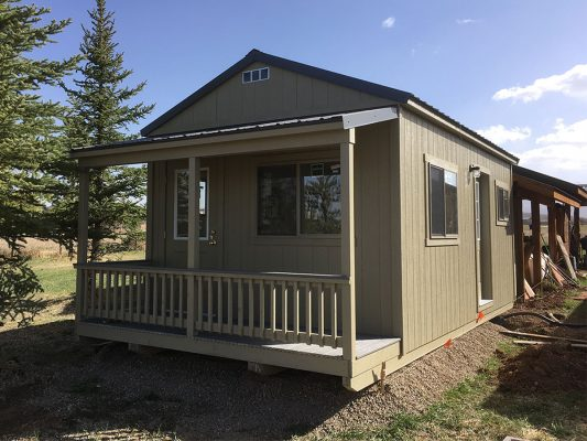 ranch shed office with front porch, two man doors, metal roof